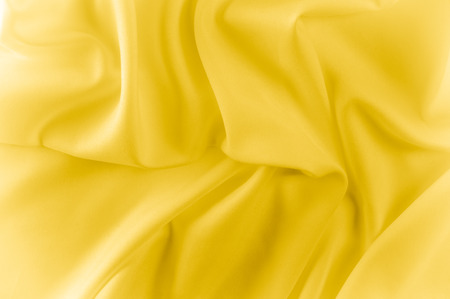 texture. silk fabric - yellow. This shiny material has a really soft and smooth surface texture that is guaranteed to add style and glare to your design