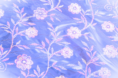 Texture, background, pattern. Pink lace decorated with flowers on a blue background. Background of pink, blue, beautifully decorated with flowers. pattern with pink lace on the blue background Stock Photo