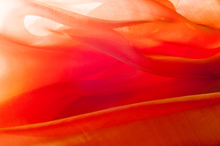 Texture, background, pattern. Orange Silk Fabric for Drapery Abstract Background. Abstract Fabric Flame Background, Artistic Waving Cloth Fractal Pattern