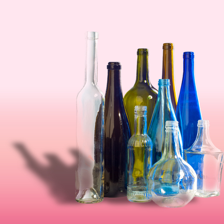 colored bottle: Background pattern, texture. Empty bottles of studio photography. Glass bottles of mixed colors, including green, transparent white, brown and blue. Group of bottles