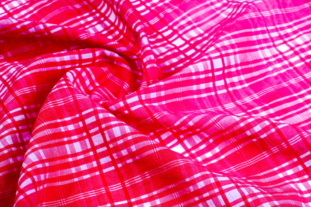 background texture. silk fabric checkered pink white. Dupioni, this is a shiny silk, often woven from two different colors of threads, Dupioni is made from irregular rough silk
