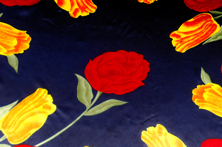 Texture, background, pattern. Cloth - silk womens handkerchief. Drawing Bright yellow red tulips on a blue background. Temple Flowers Purple Yellow Dancing Tulips Floral fabric
