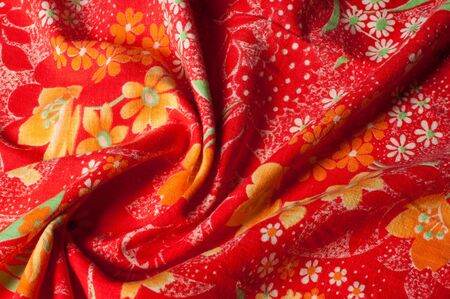 Texture, background, pattern. Cotton cloth of red color, On the fabric are painted flowers yellow white Stock fotó - 88911534