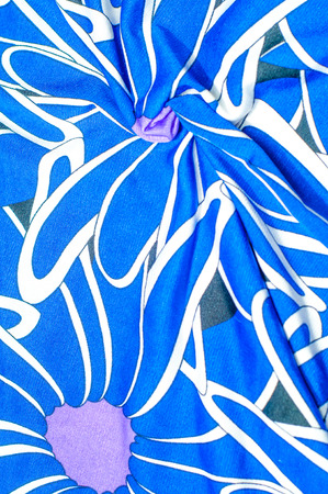 Texture, background, pattern. Womens blue silk dress. On an abstract illustration, white blue lilac tones