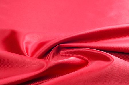 Texture, background, pattern. Red silk fabric.This satin fabric is perfect for making fabric flowers for use in hair accessories, jewery making, and fabric bouquets.