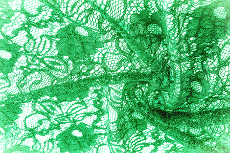 Texture, background, pattern. Cloth green lace. Background of fabric from lace stylized roses. Abstract lace pattern with flowers. Wallpaper, underwear and jewelry. Your invitations Stock Photo