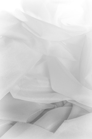 Texture, background, pattern. Texture of silk fabric - White. Silk fabric is transparent. Fabric or liquid wave illustration wavy creases of silk satin texture or velvet material or white Stock Photo