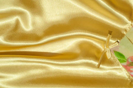 Texture, fabric, background. Abstract background of luxurious fabric or liquid waves or wavy grunge crease silk satin texture of velvet material or luxurious Christmas or elegant background. gold Stock Photo
