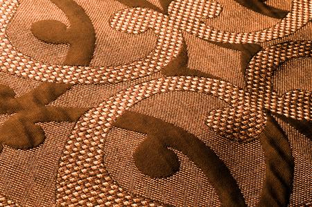 Textur, Hintergrund, Muster. Stoff Tweed Baumwolle gold-braun mit einem Blumenmuster Standard-Bild - 88912942