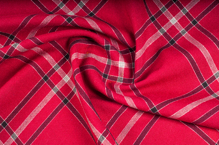texture, pattern. Scottish tartan pattern. Red and black wool plaid print as background. Symmetric square pattern. yarn dyed flannel is brushed on both sides and perfect for button down shirts, Stock Photo