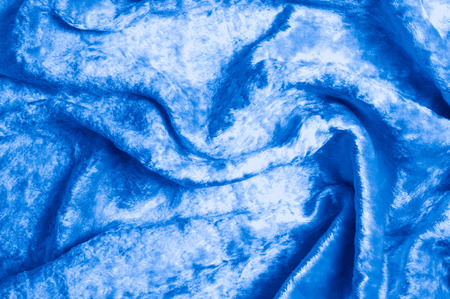 Texture, background, pattern. Cloth velvety blue. Gorgeous silk velvet fabric is a first quality velvet. The fabric is extremely soft and has a plushy texture to it. Stock Photo