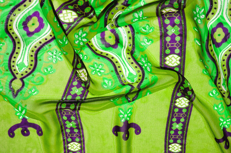 Background texture Green silk fabric with pattern. For a picture that is hard to forget, do not miss this Kelly Green and salad drawing Slim and light, it flows and moves to the waterfall.