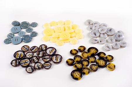white fabric texture: Texture, background, pattern. Buttons for clothes. This is a collection of vintage plastic buttons.. Plastic buttons, shank buttons, metal buttons, flat back buttons, glass buttons,