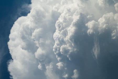Texture, background, pattern. Cumulonimbus clouds. cumulonimbus stormy cloud with blue sky. Giant cumulonimbus thunder cloud building in the sky