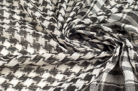 Background texture, pattern. Scarf wool like Yasir Arafat. The Palestinian keffiyeh  is a gender-neutral chequered black and white scarf that is usually worn around the neck or head. Stock Photo