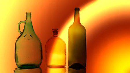 Background texture, pattern. Empty bottles. Recycling of household items, including glass,