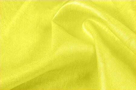 achtergrondstructuur, linnen stof geel. Wat een vondst! Linnen breisels zijn niet de gemakkelijkste items om langs te komen en als je ze opzoekt, moet je ze eerst weghalen voordat het te laat is.