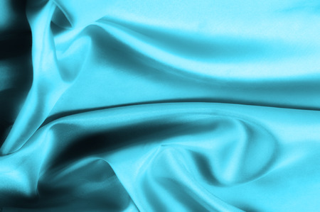 Soft focus. texture, pattern. blue silk fabric. Its deep blue flicker with a white overtones create a bit of romance and mystery, like a film set in Paris. It acts as if it has metal fibers,