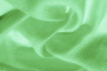 Texture, background, pattern. Fabric - silk light. Pale green fabric. Beautiful picture. Vintage Pale Fabric, suitable for lining. Polyester. Very pale green, or the right color for pies with keys.