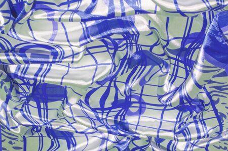 シルク。生地は白鋼で、青いラインと布の色が。それを修正このパッチワークをエキサイティングな!この材料はわずかに透明、心地よいソフト、エ 写真素材