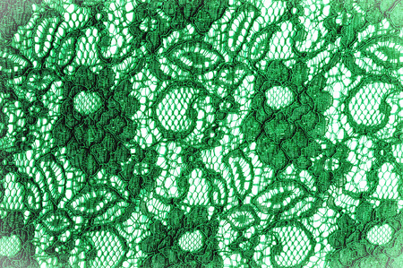 Texture, background, pattern. Cloth green lace. Background of fabric from lace stylized roses. Abstract lace pattern with flowers. Wallpaper, underwear and jewelry. Your invitations Stock Photo - 88934498
