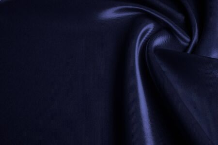 Texture, pattern. Fabric silk color cobalt, smalt, blue royal. Blue silk satin hemp Material Fabric Azure cobalt sapphire Ravenclaw Royal Stock Photo