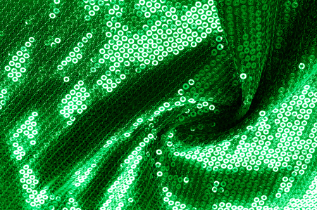 spandex: Background texture, pattern. The fabric is dark green with sequins. Make a statement with sequins ! Presenting the stylish Two-toned Paillette Sequins on the nylon spandex stretch backing.