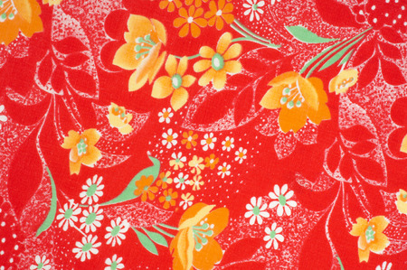 translucent red: Texture, background, pattern. Cotton cloth of red color, On the fabric are painted flowers yellow white