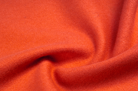 Texture, background, pattern. Vicuña fabric is a luxurious rarity. Drape of monochromatic red color Stock Photo