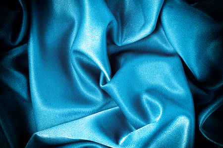Texture, background. template. Silk fabric blue, Blue silk drapery and upholstery fabric from the courtyard - Dark curtains - Solid fabrics for backs and pillows Stock Photo