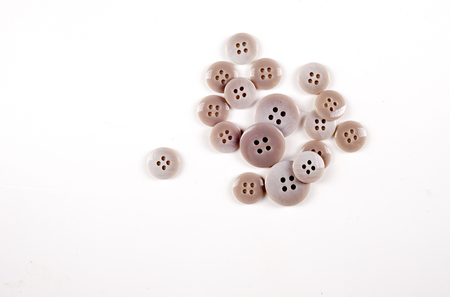 Texture, background, pattern. Buttons for clothes. This is a collection of vintage plastic buttons.. Plastic buttons, shank buttons, metal buttons, flat back buttons, glass buttons,