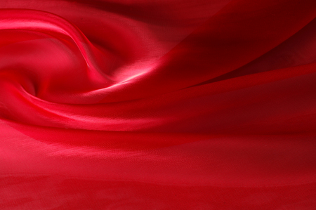 Texture, background, pattern. Red silk transparent fabric cloth texture. This is a stretch tulle, great for dresses or costumes where transparency and give is needed.  Stock Photo