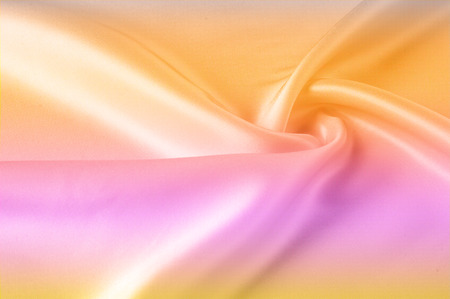 Texture, background, pattern. Silk fabric yellow, pink background. Abstract red pink orange silk background. Smooth elegant silk can be used as a background. Hot pink, yellow satin fabric close-up