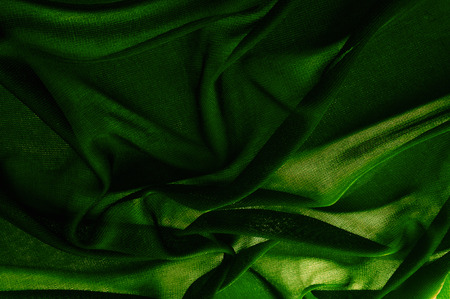 Texture, background, pattern. Green transparent fabric. Solid Hi-Multi Chiffon Dress Fabric Width Sold By The Yard Gowns Clothing Party Decorations Stock Photo