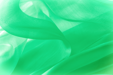 Texture, background, pattern. Green silk fabric for draping. Abstract Fabric, Artistic Waving Cloth Fractal Pattern.