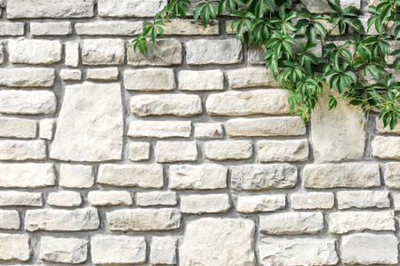 Texture background, pattern. The wall is stone. Architecture. Construction, house fencing. Sandstone cobbles