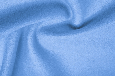 Texture, background, pattern. Woolen fabric for outdoor clothing, pale blue. Colorful, fresh spring blue. More of this motif and more textiles in my port.