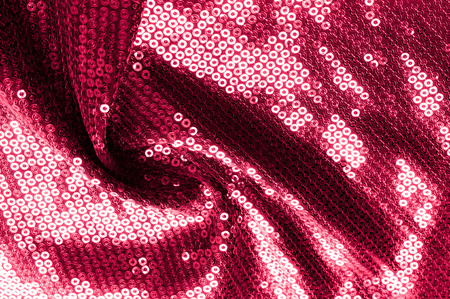 Background texture, pattern. Cloth red maroon with paillettes. Look at these Neon Pink Paillette Sequins. Round neon pink paillette sequins overlap with an iridescent sheen across a sheer purple mesh Stock fotó