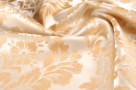 Texture, background, pattern. Fabric Upholstery Damask is a reversible figured fabric of silk, wool, linen, cotton, or synthetic fibres, with a pattern formed by weaving. Stock Photo