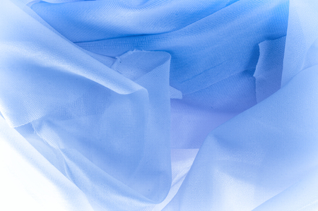 Texture, background, The texture of the silk fabric is blue. Silk fabric is transparent. Fabric or liquid wave illustration wavy creases of silk satin texture or velvet material or blue luxurious Stock Photo
