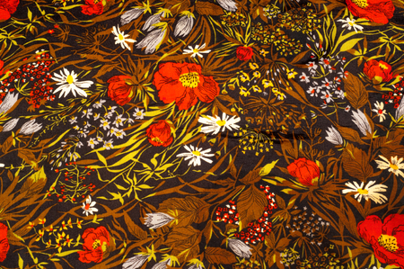 Texture, background, pattern. Silk fabric. Dark brown, painted red poppies, White camomiles. Wildflowers