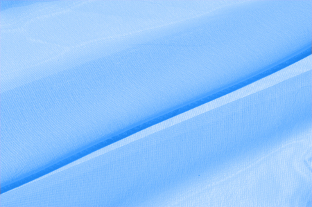 Background texture, pattern. Azure Blue Silk Twill. Here is a deluxe azure blue silk twill perfect for a vast array of applications. Almost as soft as a cloud, this remarkable silk has a supreme drape Stock Photo