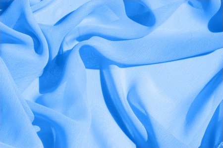 Background texture, pattern. Azure Blue Silk Twill. Here is a deluxe azure blue silk twill perfect for a vast array of applications. Stock Photo