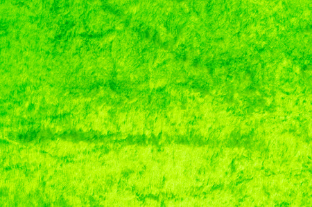 Texture, background, pattern. The fabric is velvet green. Micro velvet fabric is a high quality  polyester fabric that has a silky smooth feeling.