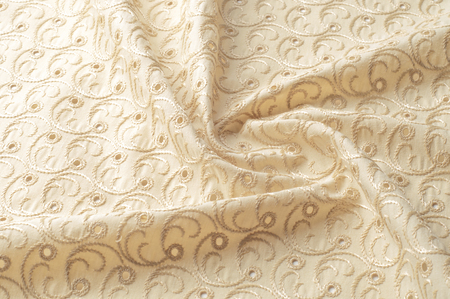 Texture background of fabric. Beige fabric with punctured circles. Beige background. Abstract geometric pattern of dots, lines. Graphic modern pattern. Neutral beige Linen fabric Background with a transparent canvas texture Close Up