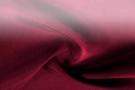 texture, thick silk fabric is red. The color is red - we see it everywhere in pop culture, fashion and beauty. And with the coming of Valentines Day, the color of the romance is greater than ever Stock Photo