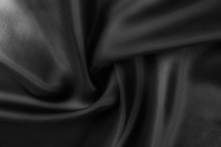 Soft focus cloth silk black. Take home this black washed silk! The washed black color is a soft, silky hand. Thin and light, it has a liquid drape that stands out when creating soft silhouettes.