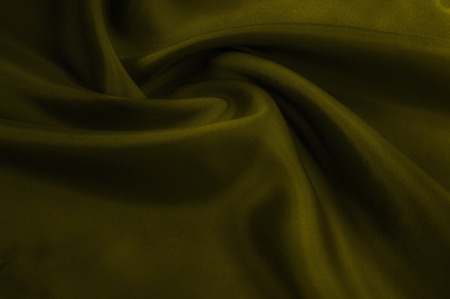 Soft focus. texture, pattern. cloth silk yellow. Mustard washed Silk Crepe de Chine. Bright mustard fabric is an ultra soft, silky hand. As the drapery folds, create sites, your designs, much more!