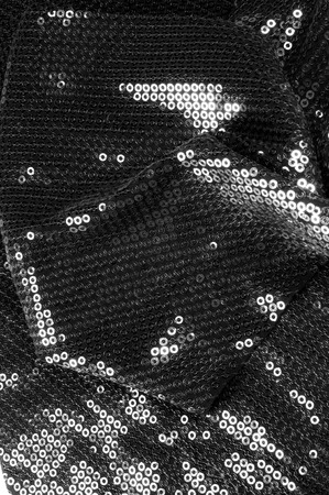 texture Fabric black with paillettes This shine, which you are guaranteed to like this material has a circular matte sequins hanging along the light georgette, creating a soundtrack with each movemen 写真素材