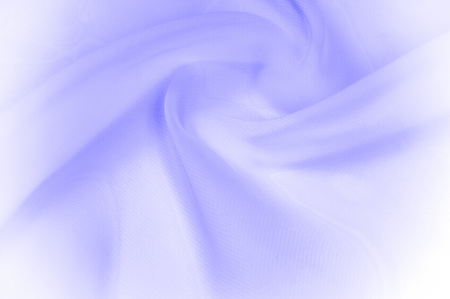blue silk transparent fabric. this silk is incredibly smooth and transparent. With flowers that disappear from one to another, and his drapery, flowing with each movement creates truly elegant figures Stock Photo